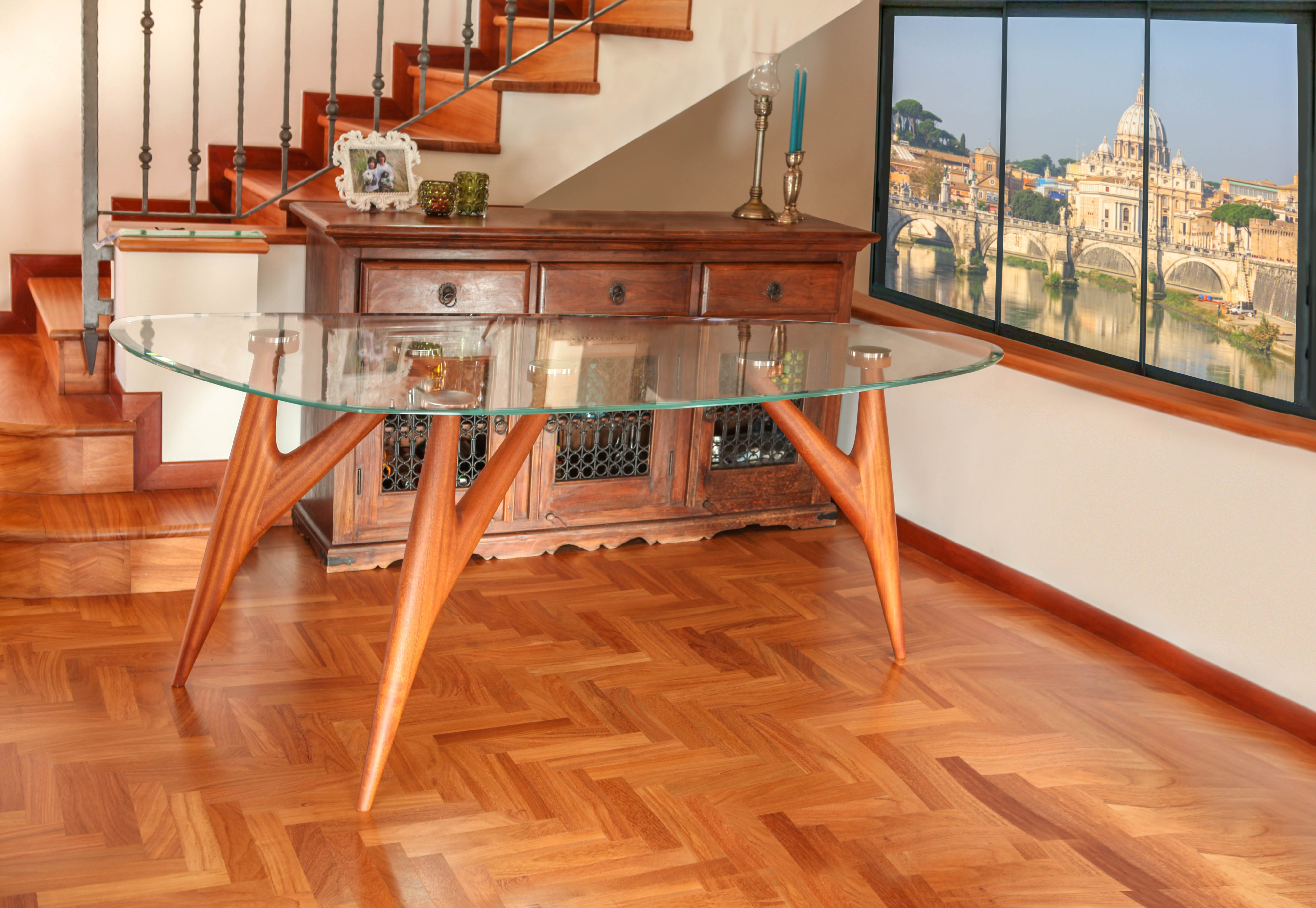 Ted 3-Legged Mahogany Dining Table. Handmade in Italy from solid mahogany wood with a clear tempered glass tabletop, this piece adds an organic, textured feel to your dining space. Able to accommodate up to eight people, this dining table allows you to entertaining guests in style. crystals precious coffeetable madeinitaly highquality from greyge